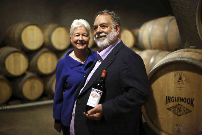 Eleanor and Francis Ford Coppola with a bottle of the 2013 Rubicon, in Rutherford, Calif., April 9, 2016. A plan by the new winemaker brought in by Coppola, Philippe Bascaules, who had spent the previous 20 years in Bordeaux at Chateau Margaux, looks ahead 50 years with ideas that run counter to Napa's conventional wisdom.  *** Local Caption *** Production de vin  NORTH AMERICA WINE MAKER GRAPE VINEYARD VINTAGE DIRECTOR INGLEHOOK CABERNET
