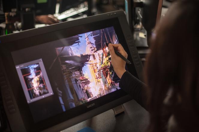 Une artiste travaille sur le jeu «Assassin's Creed», dans les bureaux d'Ubisoft Montréal.