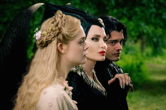Elle Fanning, Angelina Jolie et Sam Riley dans« Maléfique, le pouvoir du mal».