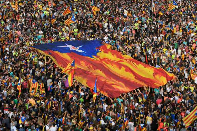 TOPSHOT - People hold Catalan pro-independence