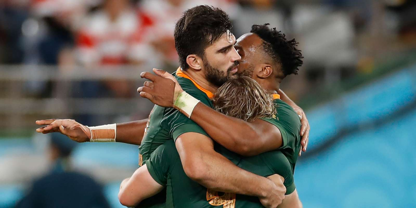 South Africa's scrum-half Faf de Klerk is congratulated by South Africa's centre Damian De Allende (L) and South Africa's centre Lukhanyo Am (R) after scoring a try during the Japan 2019 Rugby World Cup quarter-final match between Japan and South Africa at the Tokyo Stadium in Tokyo on October 20, 2019. / AFP / Odd Andersen