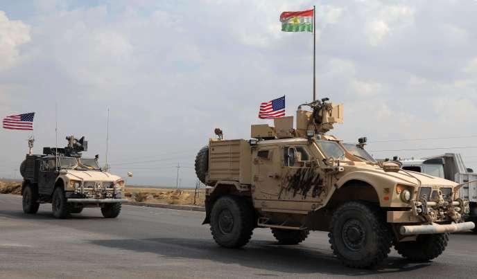 Des véhicules blindés américains arrivent dans la ville deBardarash, dans le Kurdistan irakien, lundi 21 octobre.