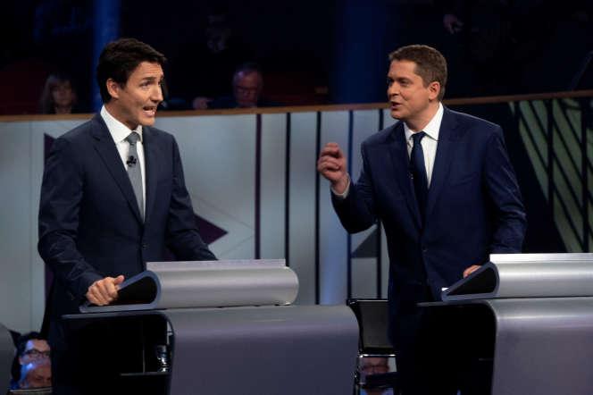 Le premier ministre canadien, Justin Trudeau, et son rivalconservateur Andrew Scheer lors d'un débat à Gatineau, le 10 octobre.