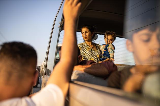 Bardarash, le 16 octobre, Irak: une dizaine de bus, avec 277 réfugiés, viennent d'arriver au camp de réfugiés de Bardarash (Kurdistan irakien).