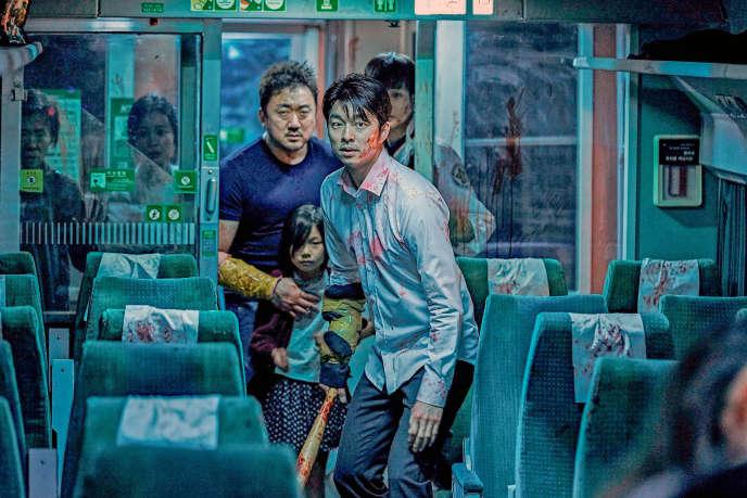 Sang-hwa (Ma Dong-seok), Su-an (Kim Su-an) et Seok-woo (Gong Yoo) dans«Dernier train pour Busan».