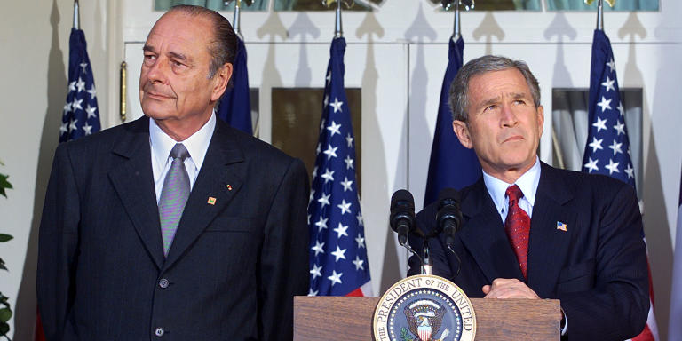 US President George W. Bush (R) and French President Jacques Chirac (L) pause during a press availability on the steps of the Rose Garden after their meeting in the Oval Office of the White House 06 November 2001 in Washington, DC. Bush and Chirac discussed solutions to combat terrorism globally and the conflict in Afghanistan.   AFP PHOTO/Stephen JAFFE (Photo by STEPHEN JAFFE / AFP)