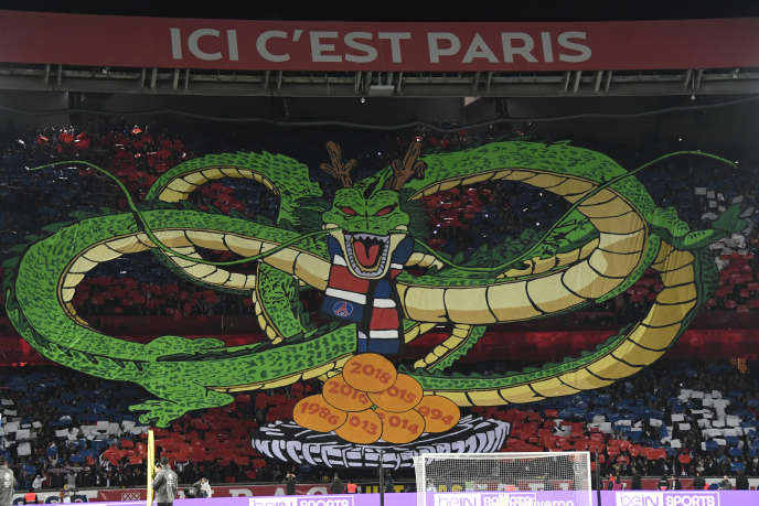 Paris Saint-Germain's supporters hold a tifo representing a character of Japanese manga Dragon ball prior the French L1 football match between Paris Saint-Germain (PSG) and Olympique de Marseille (OM) at the Parc des Princes stadium in Paris on October 27, 2019. (Photo by Bertrand GUAY / AFP)