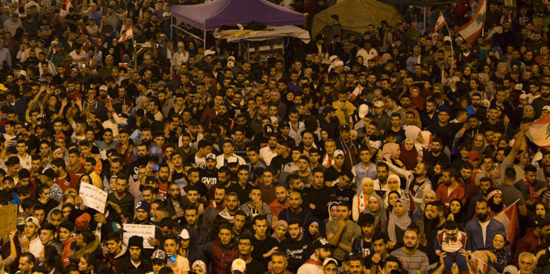 Protestors gather around the statue of Allah (Arabic for God) in al Nour Square in Tripoli, north of Lebanon, Saturday, November 2, 2019.