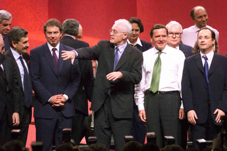 French Prime Minister Lionel Jospin (C) gestures at the end of a meeting of European socialist leaders in Paris May 27 called to plan strategy of the European Socialist parties for the European parliamentary elections. At left is Italian Prime Minister Massimo d'Alema, British Prime Minister Tony Blair (2nd L), German Chancellor Gerhard Schroeder (2nd R, in white shirt) and French Socialist Part General Secretary Francois Hollande (R).