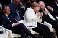 Emmanuel Macron avec la chancelière allemande, Angela Merkel, et le président russe, Vladimir Poutine, le 11 novembre à Paris.
