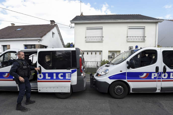 Police in front of the Truec family's home in Orville, near Nantes, in April 2019. The four family members were killed at home on February 16, 2017.