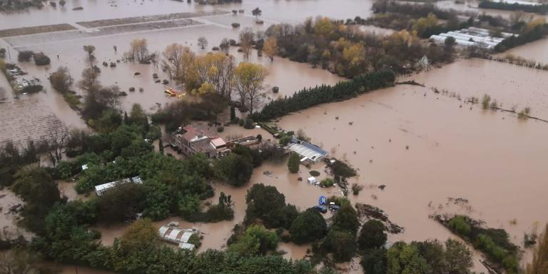 This handout picture taken and released by the French civil defence (securite civile) on November 24, 2019, shows an aerial view of flooded areas following heavy rains in Le Luc, southeastern France. Two people lost their lives and one more was missing on November 24 after historic levels of rain drenched the south of France, provoking major floods that are only now starting to recede, officials said. The Alpes-Maritimes and Var regions have since November 22 been hit by torrential rainstorms that also caused huge waves in seaside areas.  - RESTRICTED TO EDITORIAL USE - MANDATORY CREDIT