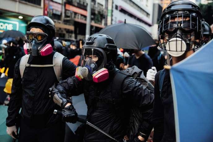 Marche contre Pékin, à l'occasion des 70ans de la Chine populaire, dans le quartier de Wan Chai à Hongkong, le 1er octobre.
