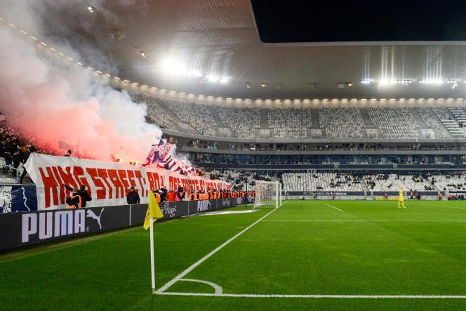 Bordeaux's fans light flares during the French L1 football match between FC Girondins de Bordeaux (FCGB) and Nimes (NO) at the Matmut Atlantique stadium in Bordeaux, southwestern France, on December 3, 2019.  / AFP / NICOLAS TUCAT