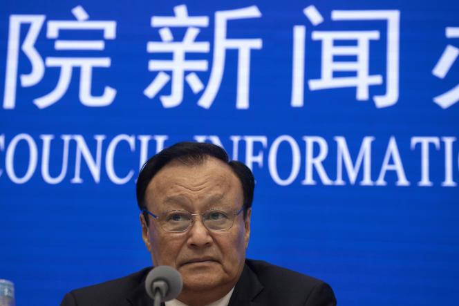 Shohrat Zakir, le président de la région autonome du Xinjiang, lors d'une conférence de presse convoquée en urgence à Pékin, le 9 décembre.