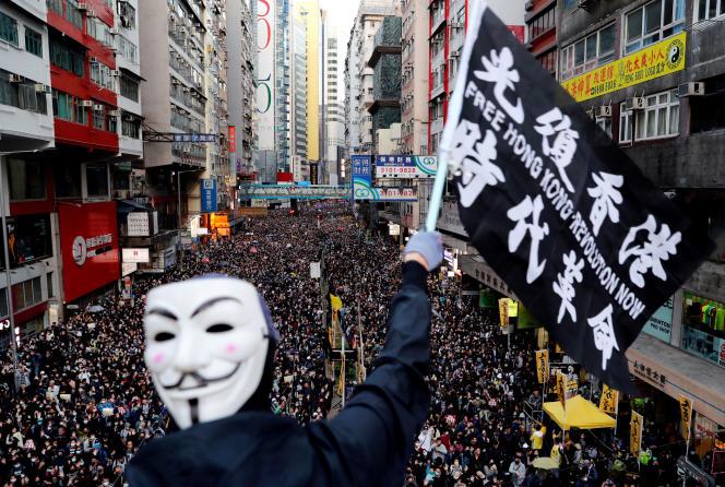 Des manifestants rassemblés à Hongkong, le 8 décembre.