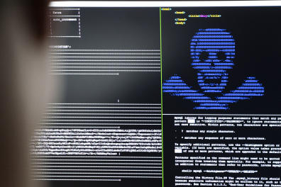 """04 December 2019, Hessen, Darmstadt: IT security scientists are training in the """"Cyber Range"""" room in the new """"Athene"""" cyber security centre how infiltrated blackmail programs (""""Ransomware"""") can be rendered harmless. The national research institute [...]"""