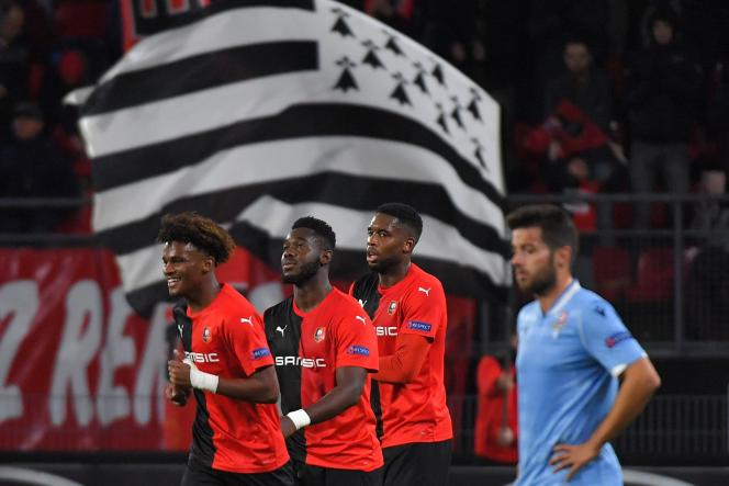 Rennes' French defender Joris Gnagnon (2L) celebrates after scoring a goal during the UEFA Europa League Group E football match between Stade Rennais Football Club and SS Lazio at the Roazhon Park in Rennes, northwestern France on December 12, 2019.  / AFP / LOIC VENANCE