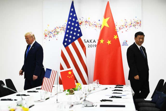 Le président chinois Xi Jinping (ç droite) et le président américain, Donald Trump, lors d'une réunion bilatérale en marge du sommet du G20, à Osaka (Japon), le 29 juin.