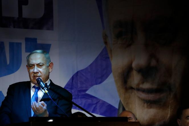 Le premier ministre israélien, Benjamin Nétanyahou s'adressant au militants du parti Likoud lors de sa campagne électorale à Petah Tikva, près de Tel Aviv, le 18 décembre.