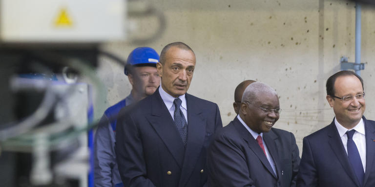 Mozambique's President Armando Guebuza, center, shakes hands with France's President Francois Hollande as the head of CMN (Construction Mecanique de Normandie) Iskandar Safa stands behind, at the CMN shipyard in Cherbourg, northwestern France, Monday, Sept. 30, 2013. French President Francois Hollande is vaunting a 200 million euro ship contract from Mozambique as a model for France's industrial renewal, and as salvation for Cherbourg's ship-building industry. (AP Photo/Michel Euler)