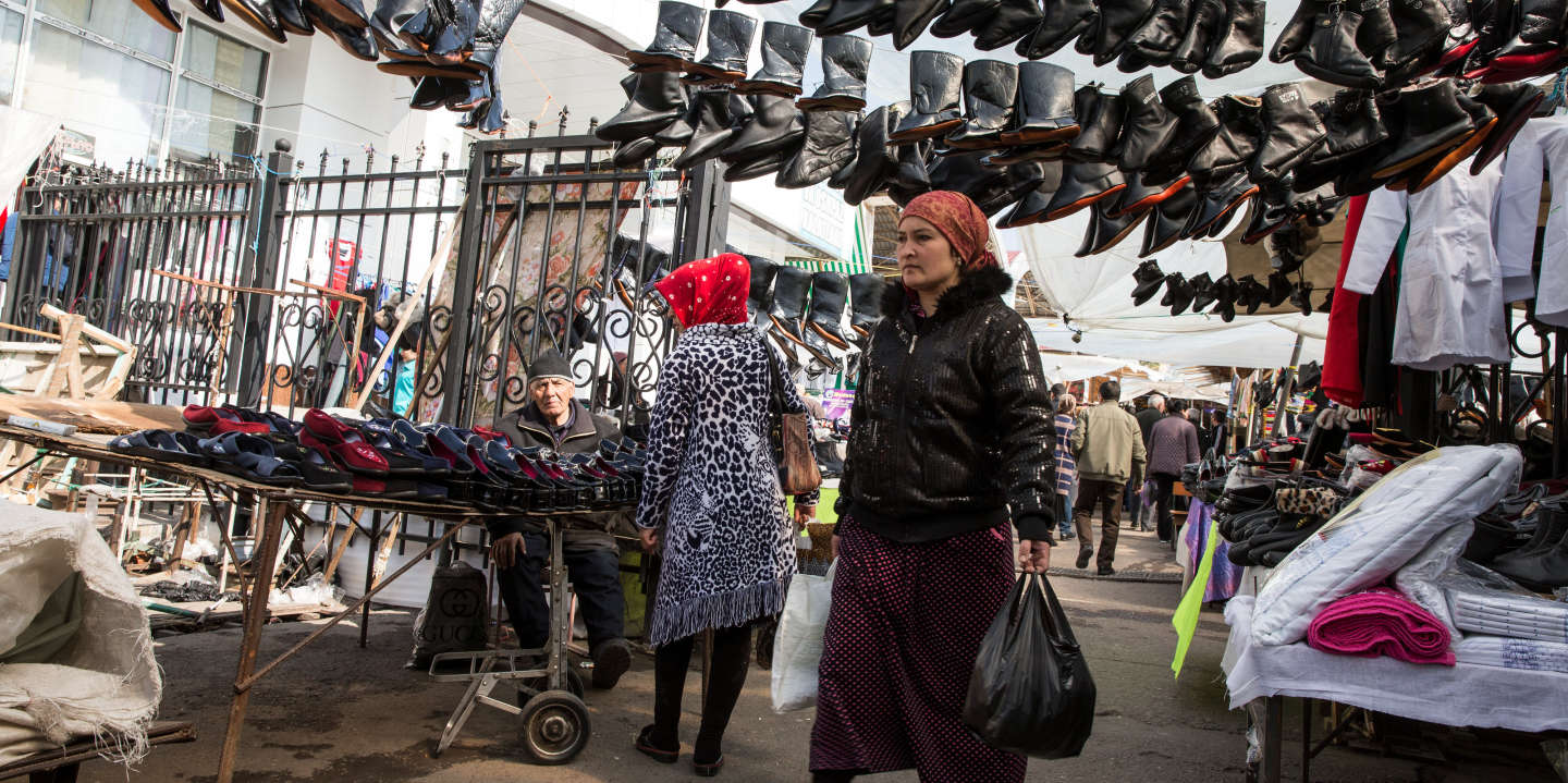 A shopper walks under boots hanging from footwear stalls at Chorsu Bazaar in Tashkent, Uzbekistan, on March 2, 2018. Uzbekistanknows it has plenty of catching up to do after sitting out much of the economic transformation that's swept across the former Soviet Union during more than two decades since the end of communism. Rapid-fire reforms have followed the death of long-time rulerIslam Karimovin 2016, with PresidentShavkat Mirziyoevlifting currency controls and easing some travel restrictions.Photograph: Taylor Weidman/Bloomberg via Getty Images