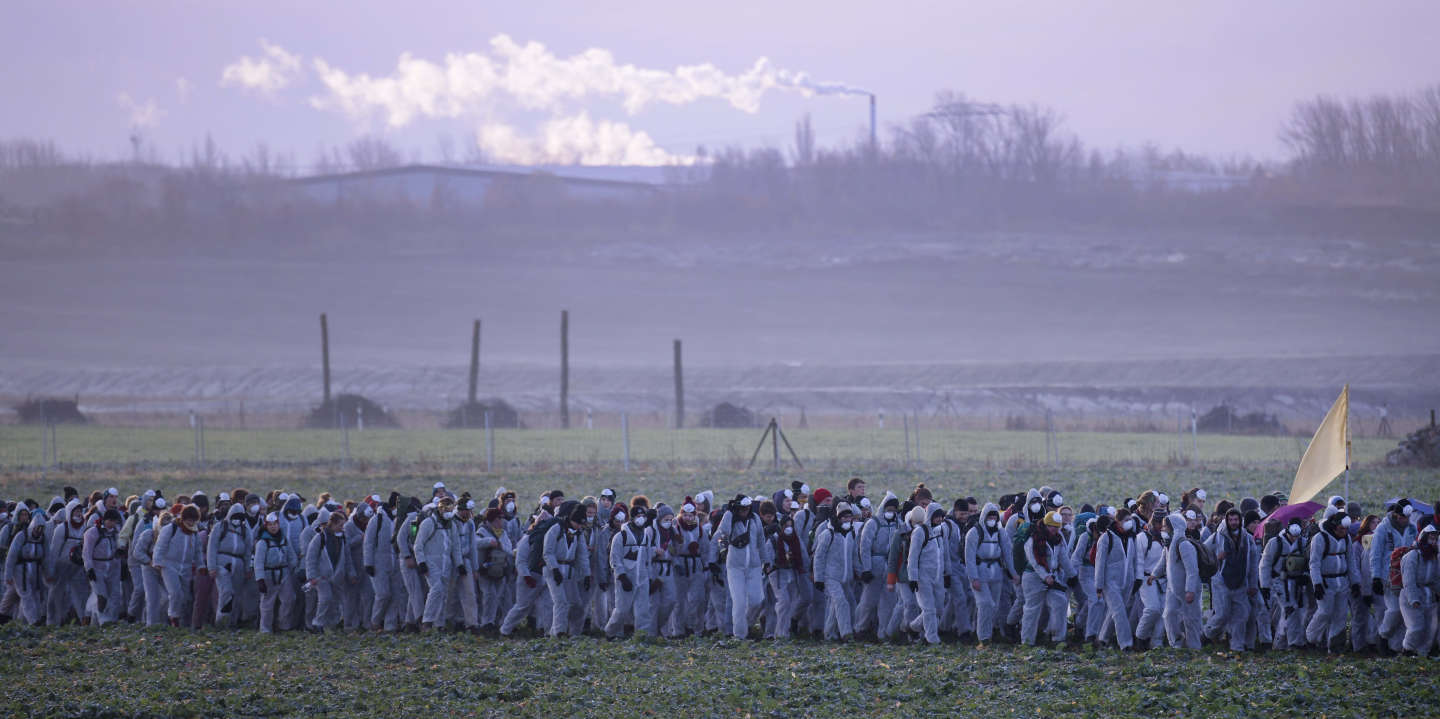 Supporters of the climate movement Ende Gelaende protest in front of a coal-fired power station Lippendorf near Leipzig, Germany, Sunday, Nov. 24, 2019. Ende Gelaende is an action alliance for an immediate coal exit, climate justice and a fundamental system change. The alliance announces a mass action of civil disobedience in the Saxony and Lusatian coal mining area in Germany. (AP Photo/Jens Meyer)