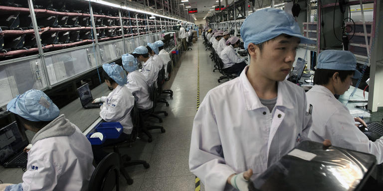 FILE-- Employees of Hewlett-Packard, a pioneer in using trains to transport computers and accessories made in inland China, oversee laptop production in Chongqing, China, Nov. 27, 2012. Following the ancient Silk Road trading path, manufacturers are shipping products made in China on specially guarded trains to markets in Western Europe.