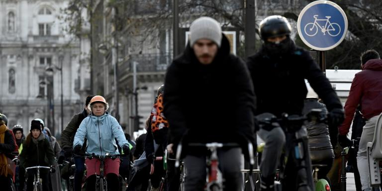 People ride bicycles in central Paris early on December 10, 2019 on a sixth day of a strike of public transport operators SNCF and RATP employees over French government's plan to overhaul the country's retirement system. Unions have vowed to keep up the fight over the reforms, which are set to be finalised and published on December 11. Another mass demonstration is planned in Paris and other cities today, with teachers and other workers once again expected to walk out alongside transport workers.  / AFP / Philippe LOPEZ