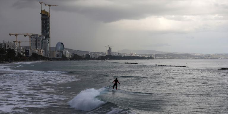 A surfer rides a wave on Christmas Day at Limassol, Cyprus  December 25, 2019. REUTERS/Yiannis Kourtoglou