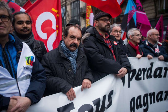 Philippe Martinez (CGT) et Yves Veyrier (FO), le 9 janvier, lors d'une manifestation à Paris.