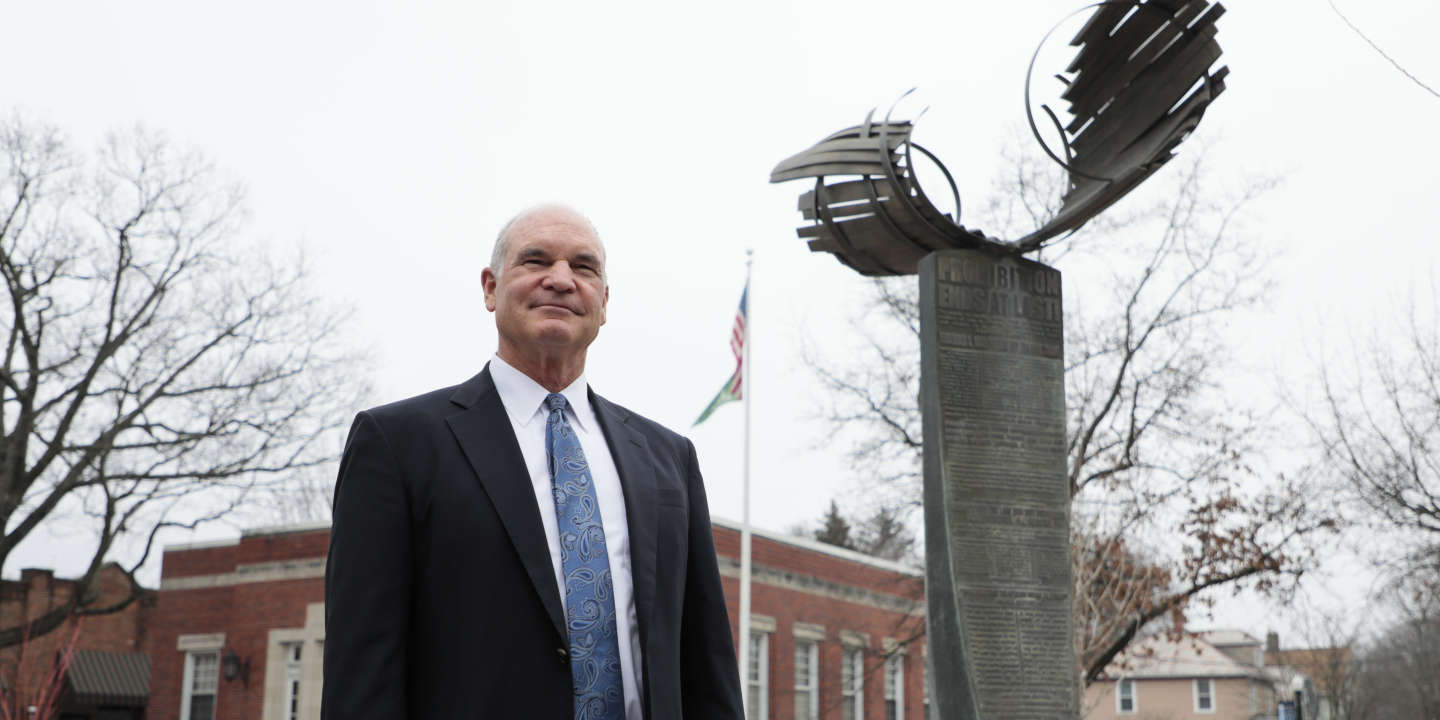 Bruce Bailey, law director for the City of Westerville, poses for a portrait near the sculpture