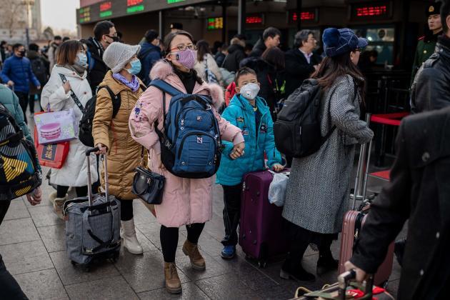 A la gare de Pékin. Les déplacements massifs à l'occasion des célébrations du Nouvel An lunaire présentent un risque de propagation de l'épidémie.