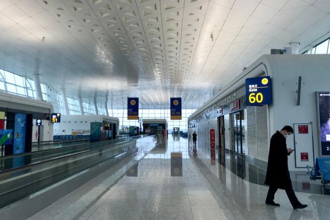 A l'aéroport de Tianhe, à Wuhan, le 23 janvier.