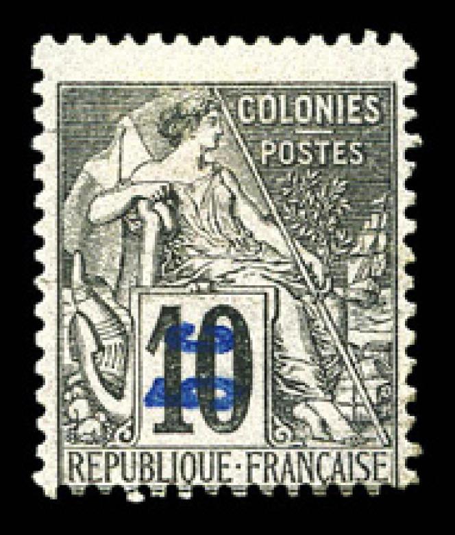 Nossi-Bé, type «Paix et commerce», «5 c» surchargé sur 10 centimes noir sur lilas surcharge verticale, à 1900 euros.