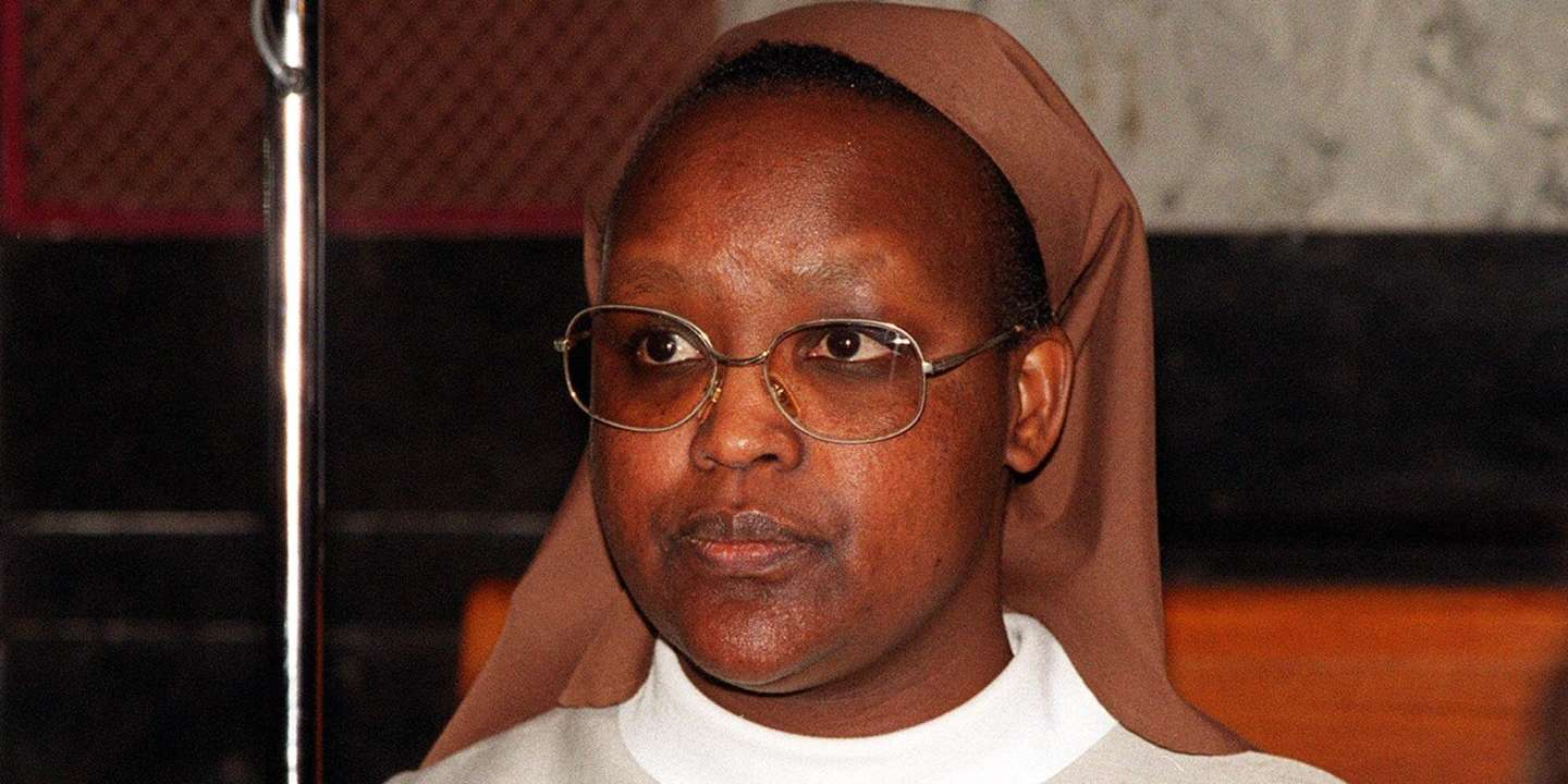 Benedictine Sister Gertrude, 42, born Consolata Mukangango, appears in front of a criminal court in Brussels, Tuesday April 17, 2001. Jury selection began Tuesday in a landmark trial at which four Rwandans, including two Roman Catholic nuns, face charges of aiding and abetting the murder of Tutsis as part of the genocide that swept the Central African nation in 1994. Sister Gertrude forced hundreds of Tutsis hiding in her convent to leave knowing they were going to be killed. Some 600 died on May 5, the prosecution alleges. Sister Gertrude asked officials to remove the last remaining 30 Tutsis who were then killed May 6.(AP Photo/Thierry Charlier)