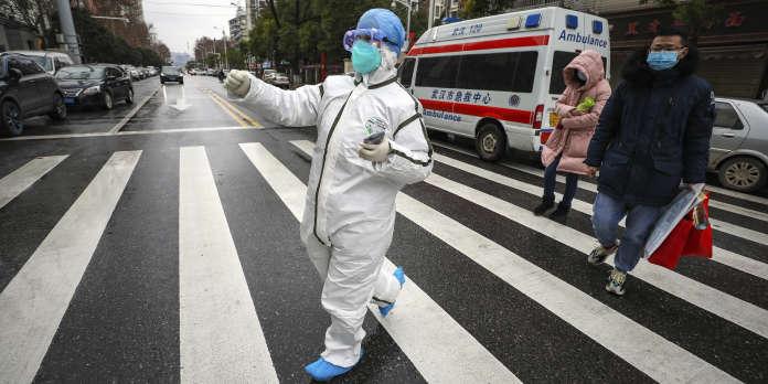 Face au coronavirus, les villes de Chine tentent de se barricader dans une atmosphère de psychose