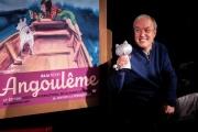 Emmanuel Guibert reçoit le Grand prix du Festival d'Angoulême, le 29 janvier.