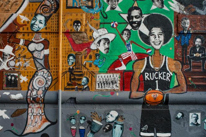 Fresque représentant les « Black Heroes» à l'angle de la 126e Rue et de Malcolm X Boulevard.