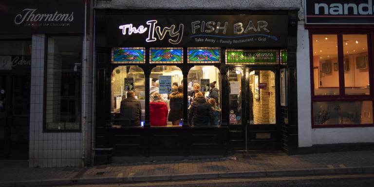 Customers fill the Ivy fish-and-chip shop on the high street in Ivybridge, England, on January 29, 2020. Since the UK joined the Common Market in 1973—when a parade was held past these shops—the town has swelled in size from 2000 people to 14000, believed to be the fastest growing town in Europe at one point.