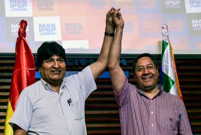 L'ex présidentbolivienEvoMorales et le candidat aux présidentielles LuisArceà Buenos Aires, le 27 janvier.