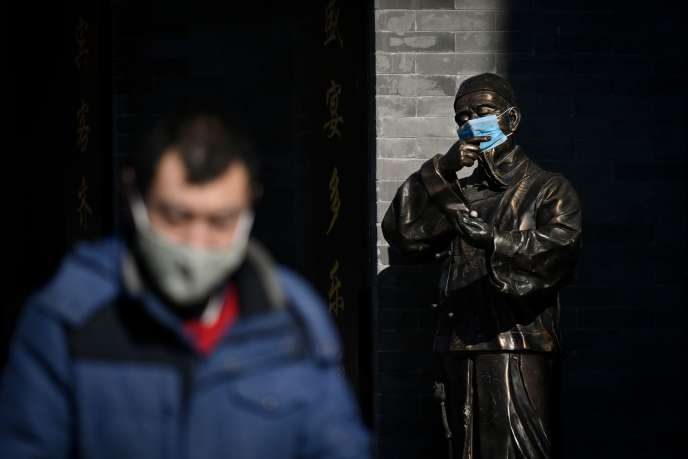 Dans une rue de Pékin, le 4 février.