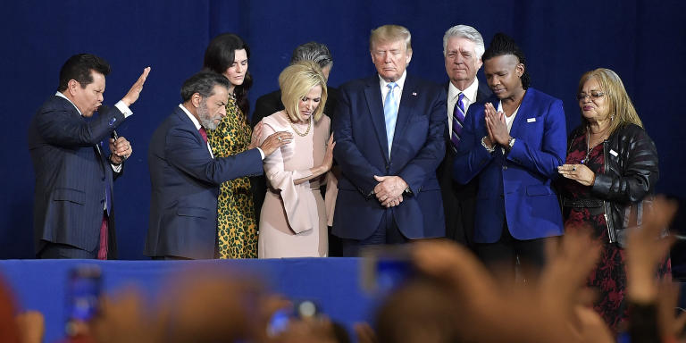 """January 3, 2020 - Miami, Florida, United States: Guillermo Maldonado (1L), pastor of King Jesus International Ministry Church, making speech, Pastor Paula White-Cain holding President Donald J. Trump's arm, as he is surrounded and prayed for by pastors of the church during a Evangelicals for Trump rally at King Jesus International Ministry. Trump launched the """"Evangelicals for Trump"""" initiative by visiting El Rey Jesús Global, a megachurch in Miami led by Rev. Samuel Rodriguez, a Latino pastor who has visited the White House and publicly praised the president. Rodriguez, president of the National Hispanic Christian Leadership Conference, was delighted that Trump's first campaign move of the year is taking place at a Latino megachurch in the state of Florida, where Cubans were about twice as likely as non-Cuban Latinos to vote for Trump. (Michael Laughlin / SF Sun Sentinel / Polaris)    249353 2020-01-03 FL - Florida Miami Etats-Unis"""