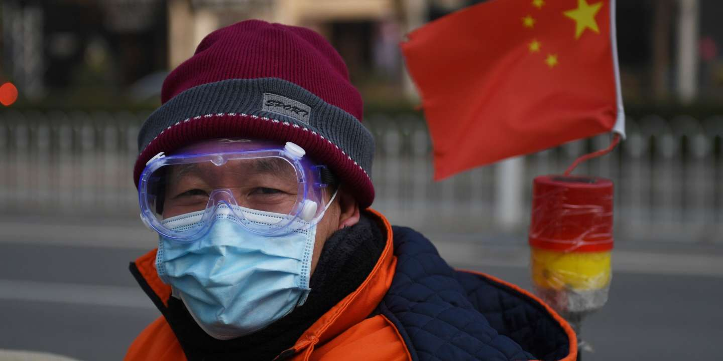 A cleaner wears a mask and goggles as he commutes on a street in Beijing on February 11, 2020. The death toll from a new coronavirus outbreak surged past 1,000 on February 11 as the World Health Organization warned infected people who have not travelled to China could be the spark for a