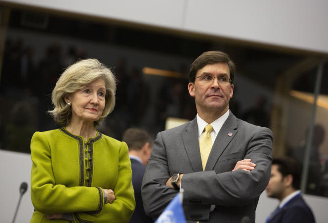 U.S. Secretary for Defense Mark Esper, right, and U.S. Ambassador to NATO Kay Bailey Hutchison wait for the start of a meeting of the Resolute Support Mission at NATO headquarters in Brussels, Thursday, Feb. 13, 2020. NATO ministers, in a second day of meetings, will discuss building stability in the Middle East, the Alliance's support for Afghanistan and challenges posed by Russia's missile systems. (AP Photo/Virginia Mayo)