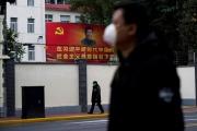 Le président chinoisXi Jinping sur une affiche dans une rue de Shanghaï, le 10 février.