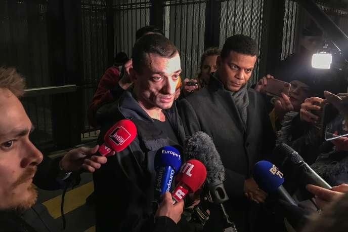 Piotr Pavlenski, accompagné de son avocat Yassine Bouzrou, à sa sortie du tribunal judiciaire de Paris après sa mise en examen, le 18 février.