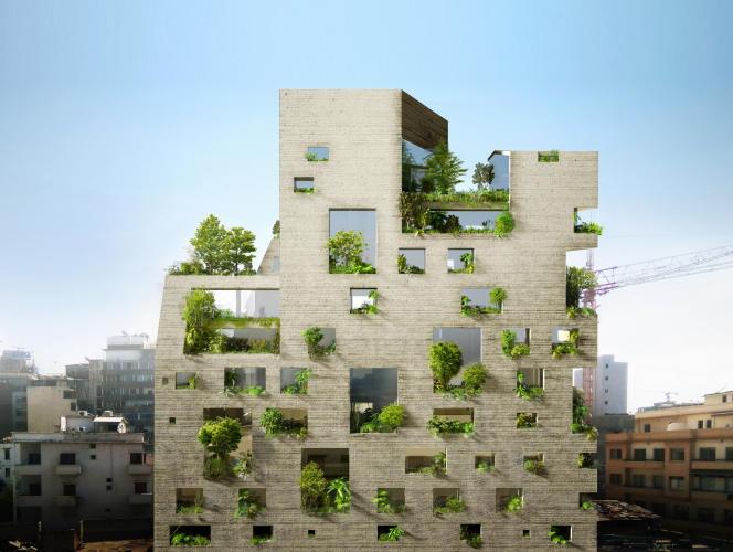 Située à proximité du port industriel de Beyrouth, cette tour de logements en terre, «Stone Garden», a été conçue par l'architecte Lina Ghotmeh. Sa façade a été entièrement «labourée» par des mains d'artisans. Ces fenêtres, avec leurs tailles différentes, font entrer la lumière et la verdure.