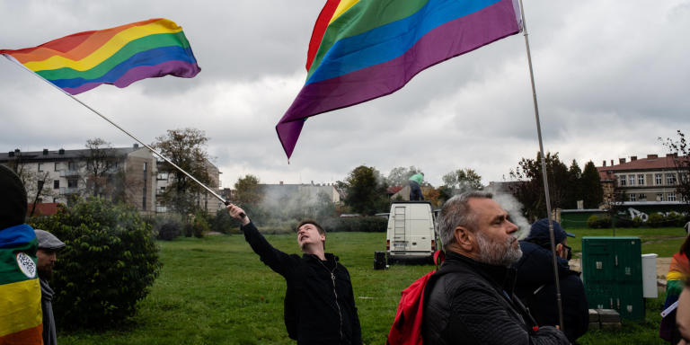 People take part in a LGBT pride march where a strong police presence sought to prevent violence before forth coming parliamentary elections. *** Local Caption *** europe LGBT+ rights people activism flags human rights