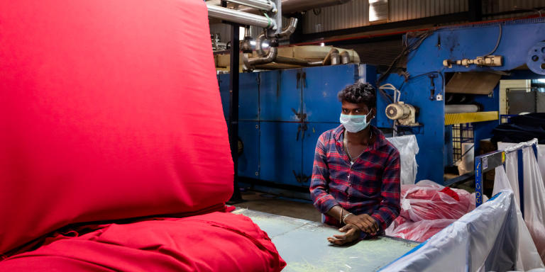 Textile dyeing in process at GMS Processors Private Limted in Arulpuram near Tiruppur, Tamil Nadu, India.